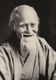 Maître Ueshiba Riait-il des grades?